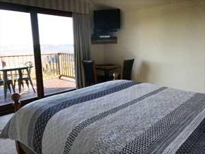 Loft suite bed overlooking cliffs